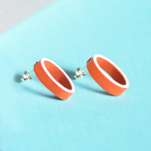 Lush orange oval earrings with white edge, silver studs
