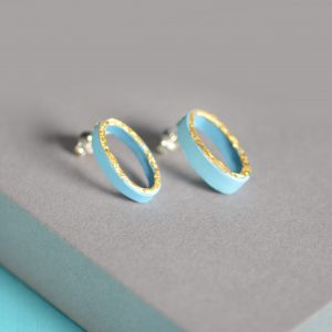 Pale blue oval earrings with gold front, silver studs