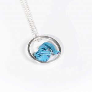 Round silver pendant with wave formed brass painted in blue colour