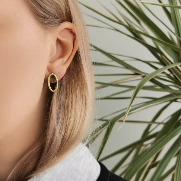 Oval earrings with gold front, worn