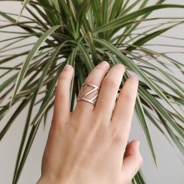 Geometric ring in matt silver, on a hand