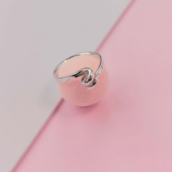 Silver ring with swirl on top, photographed from the top